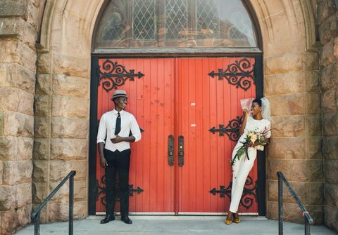 couple in front of church doors