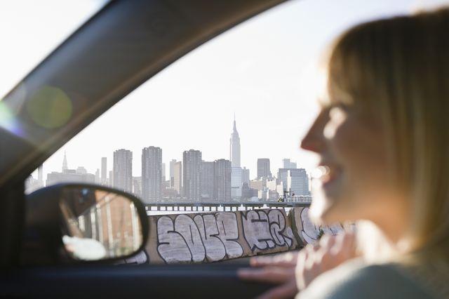 usa, brooklyn, williamsburg, woman driving through city