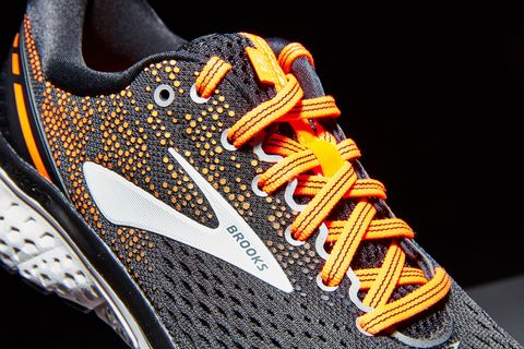 Footwear, Running shoe, Shoe, Orange, Sneakers, Yellow, Athletic shoe, Tennis shoe, Walking shoe, Outdoor shoe,