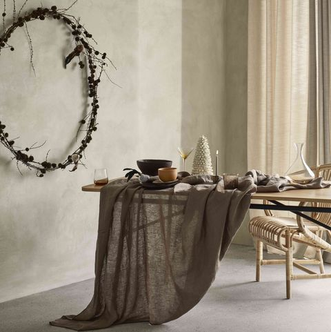minimalist christmas wreath ands table setting by broste copenhagen