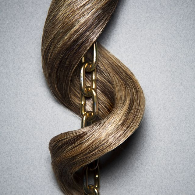 brown hair wrapping curling around linked chain