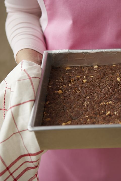 Cashew-caramel brownie in baking pan, elevated view