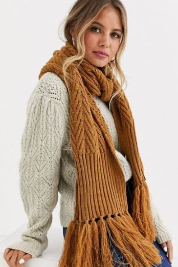 Clothing, Scarf, Wool, Woolen, Outerwear, Hairstyle, Brown, Long hair, Fur, Sweater,