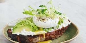 Bruschetta with avocado, ricotta and poached egg