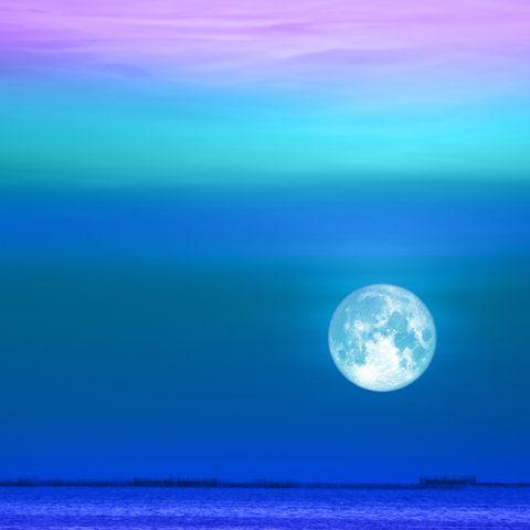 buck moon back on heap red cloud on night sky
