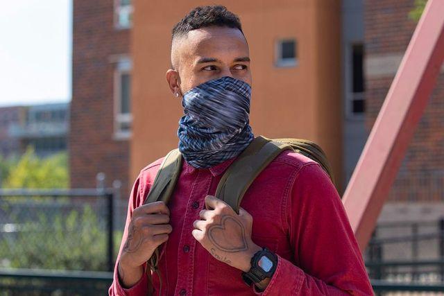 a man wearing a neck gaiter as a face mask