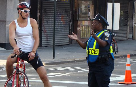 A cyclist and a police officer.