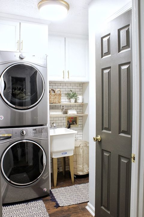built in stacked washer dryer laundry room