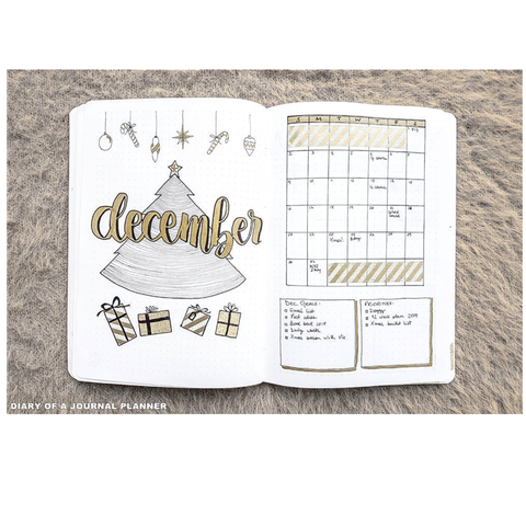 a december monthly spread by diary of a journal planner