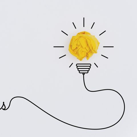 Bulb Idea Concepts with Yellow Crumpled Paper Ball