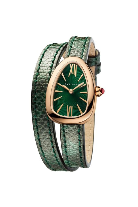 Analog watch, Watch, Watch accessory, Green, Strap, Fashion accessory, Jewellery, Material property, Brand, Hardware accessory,