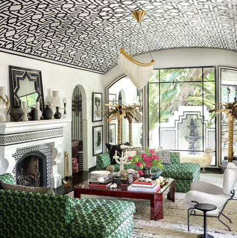 Living room with two green sofas and patterned domed ceiling