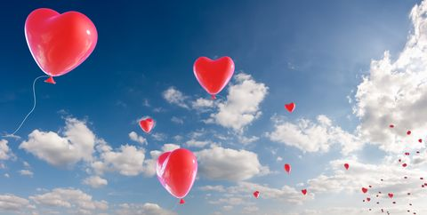 bunch of heart shaped balloons appearing from royalty free image