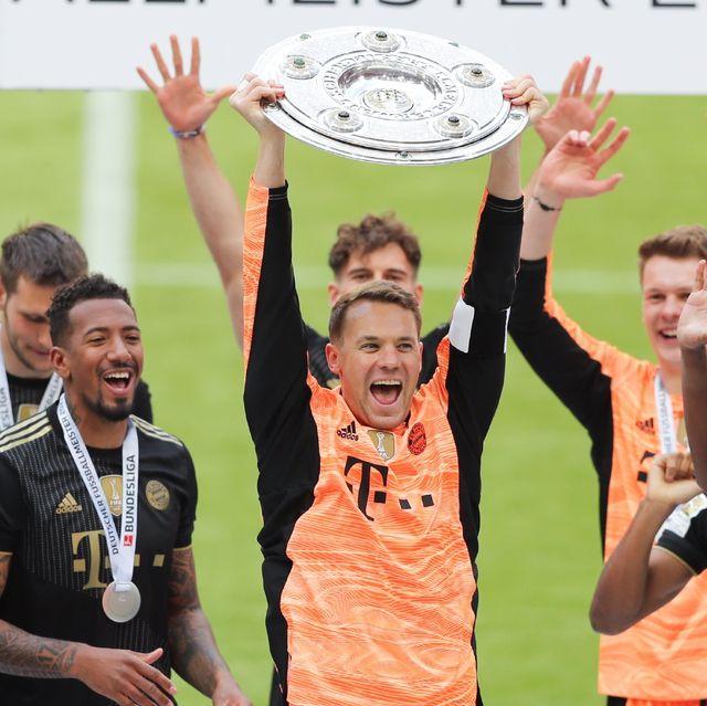 manuel neuer of bayern muenchen lifts the bundesliga meisterschale trophy