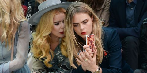 Cara Delevingne on the Burberry front row