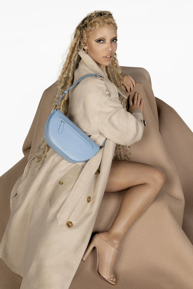 fka twigs wears pale blue burberry olympia bag