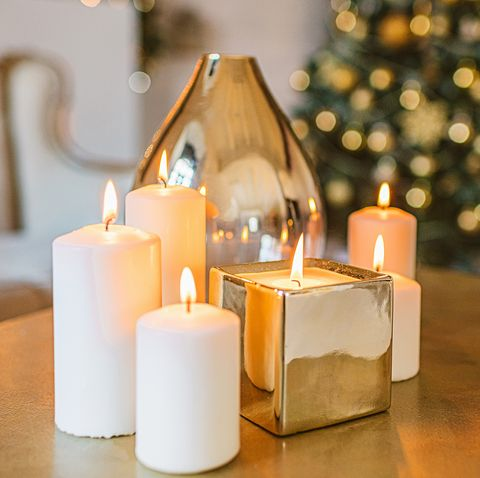 burning golden candles  living room christmas decoration, christmas background, white and gold colors, winter holidays background, interior