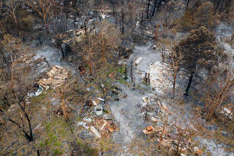 bush fire destruction with home