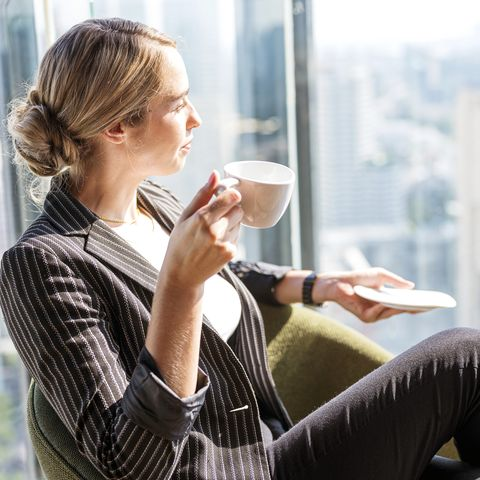 business people, relax and leisure concept happy smart business woman with cup of tea or coffee at modern office