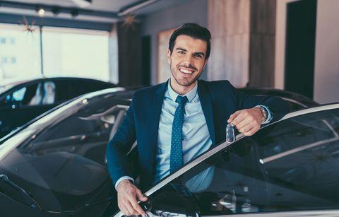 Businessman enjoying new car