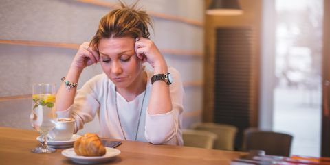 businesswoman at coffee break having a headache