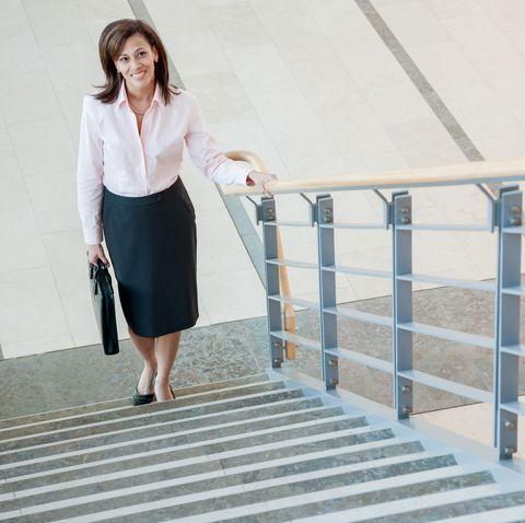 Businesswoman climbing a stairway