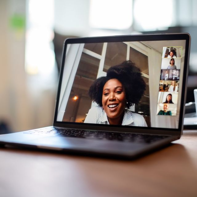 businesswoman having a video call meeting with her team