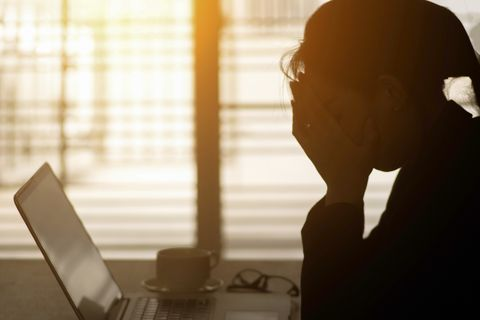 businesswoman using computer in the office stress in the office