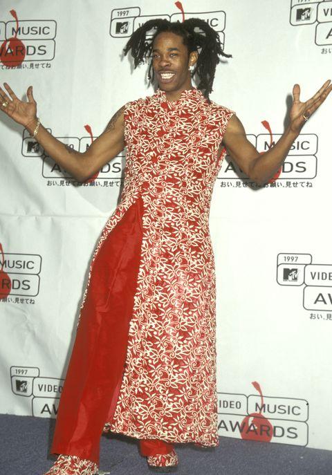 Clothing, Red carpet, Dress, Carpet, Flooring, Formal wear, Joint, Fashion design, Premiere, Event,