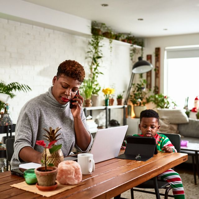 Busy working mother making phone calls from home