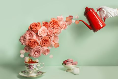 buttler pouring a stream of roses into tea cup