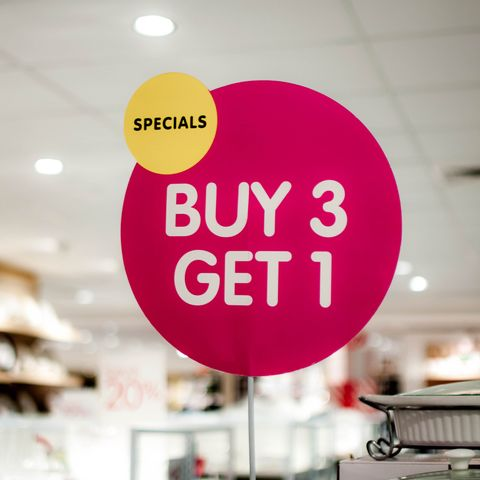 "A ""buy 3, get 1"" sign on a shopping mall"