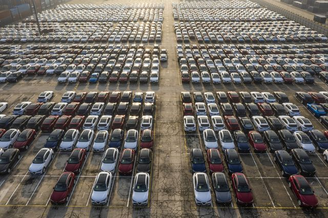 aerial shot of new cars lineup up in the port for import and export