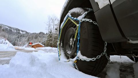15 january 2019, bavaria, obermaiselstein a car with snow chains pulled up stands at the entrance of the closed riedberg pass photo karl josef hildenbranddpa photo by karl josef hildenbrandpicture alliance via getty images