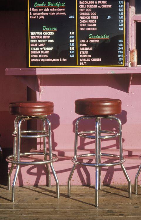 Bar stools at an outdoor hamburger stand, Los Angeles, CA