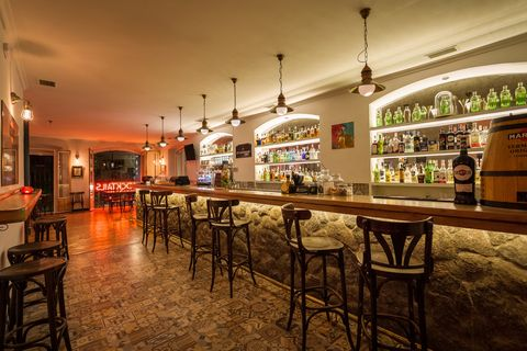 Building, Property, Restaurant, Interior design, Bar, Room, Sky, Real estate, Pub, Table,