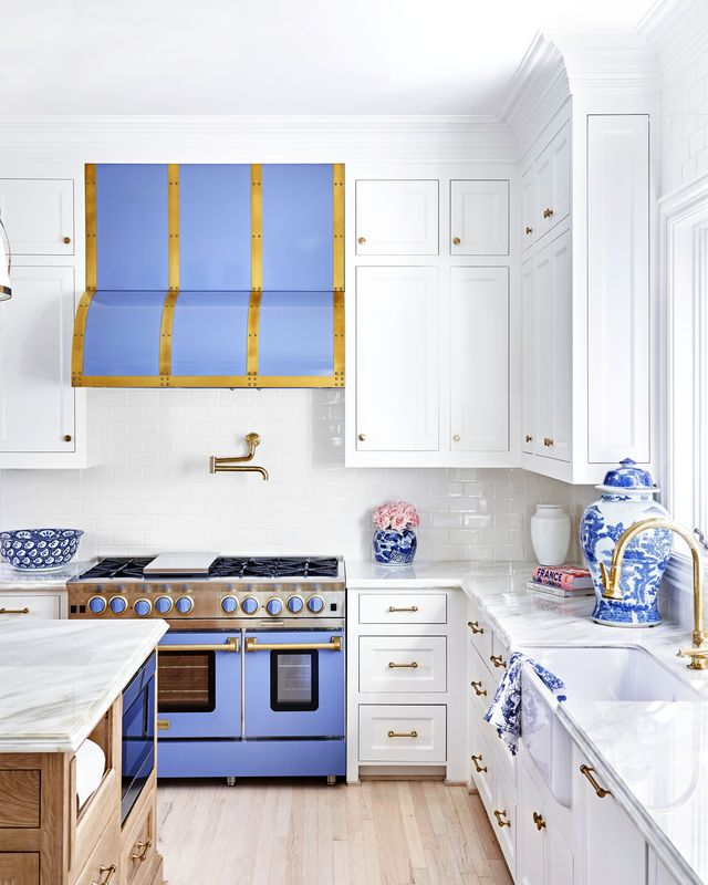 white kitchen with periwinkle range and hood