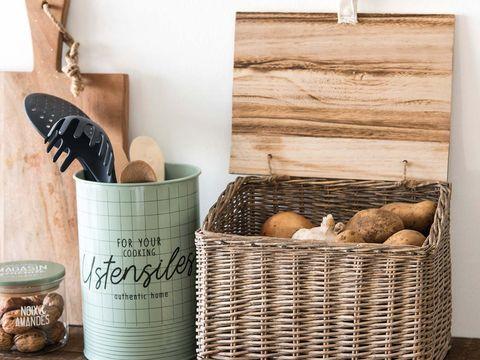 Storage basket, Basket, Wicker, Picnic basket, Hamper, Home accessories, Gift basket, Room, Wood, Plant,