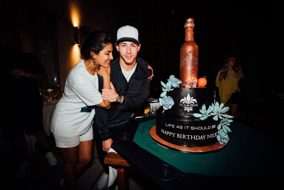 Nick Jonas Celebrated His 27th Birthday With A Giant Cake Shaped Like His New Tequila Bottle