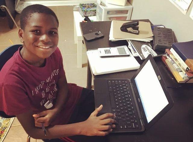 kid genius caleb anderson at his computer