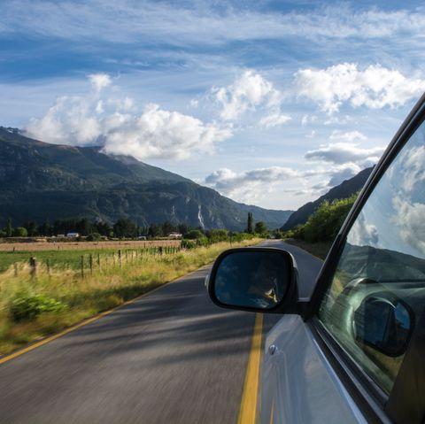 Road, Highland, Sky, Mode of transport, Mountainous landforms, Road trip, Mountain, Cloud, Natural environment, Mountain range,