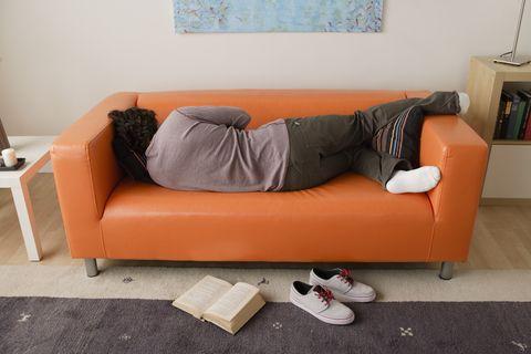 usa, california, los angeles, man sleeping on sofa