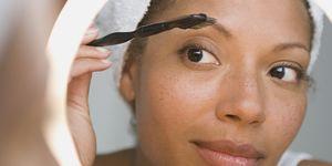 USA, California, Los Angeles, Woman brushing eyebrow