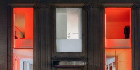 Architecture, Facade, Red, Orange, Fixture, Rectangle, Material property, Symmetry, Concrete, Column,