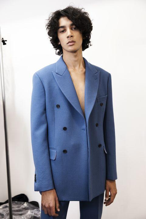 Clothing, Blue, Suit, Outerwear, Overcoat, Coat, Blazer, Jacket, Formal wear, Fashion,