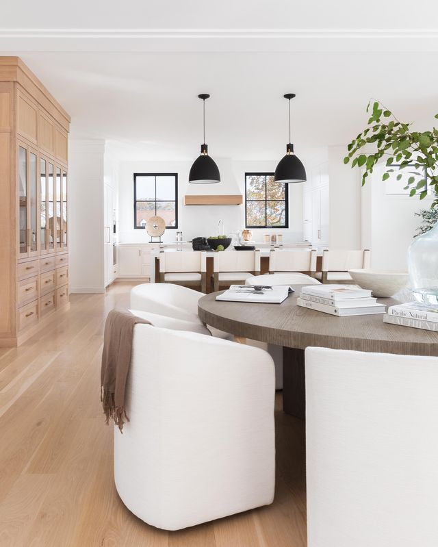 white kitchen, white chairs, wood table