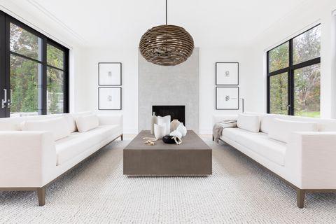 white couch, gray carpet living room