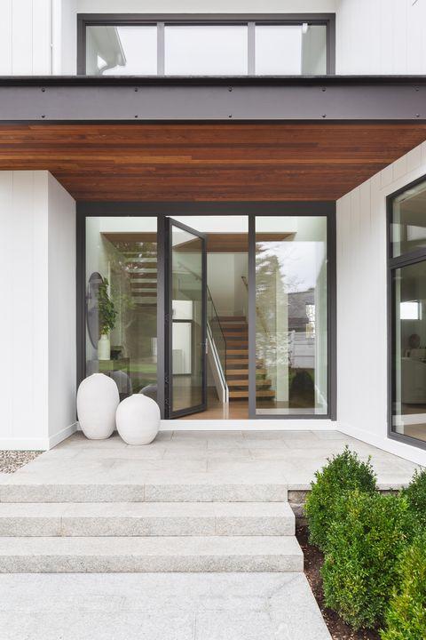 Entrance, glass doors, stone tiles