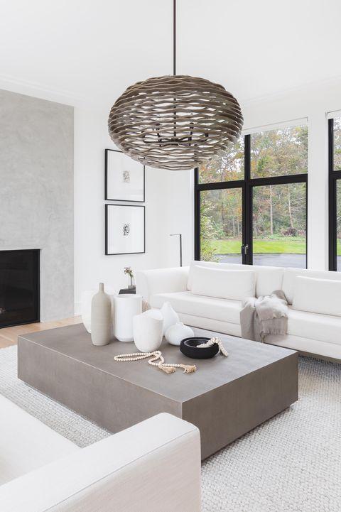 white sofas, gray carpet, coffee table, fireplace