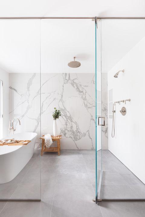 Bathroom, marble wall, white bathtub
